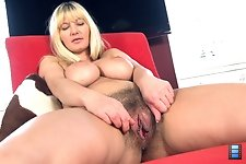 Busty Vanessa J rubs her big tits all the way down to her legs before rubbing up to her wet hairy pussy through her black hot shorts. She takes them o